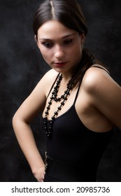 elegant woman portrait , studio dark