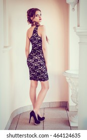 elegant woman in a short cocktail dress