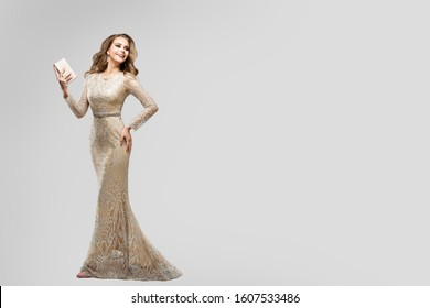 Elegant Woman in Sparkling Evening Dress, Happy Fashion Model in Long Lace Gown, Beauty Studio Portrait