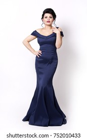 elegant woman wearing evening gown in dark blue or navy color on white background