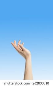 Elegant womans hand reaching blue peaceful sky