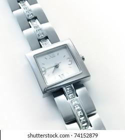 Elegant women's luxury silver wrist watch with diamonds