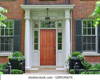 elegant wooden front door of house with portico entrance