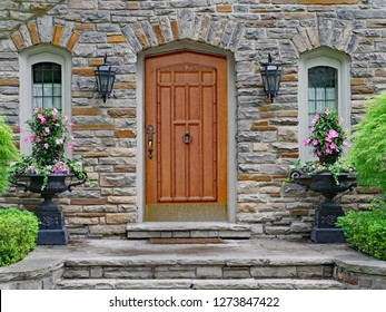 elegant wooden front door of stone house