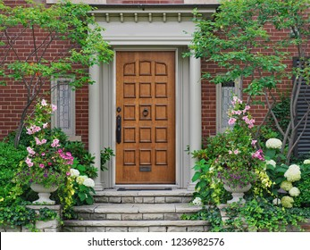 elegant wooden front door surrounded by flowers