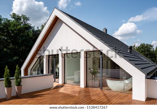 Elegant wooden home terrace with balcony doors from bathroom and bedroom