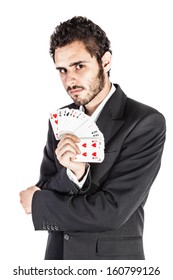 an elegant young businessman holding a deck of playing cards isolated over a white background