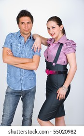 Elegant young couple posing in a fashion style