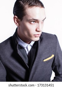 Elegant young fashion model. Studio fashion portrait.
