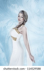 Elegant young fashion woman with snow frost winter make-up