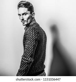 Elegant young handsome man. Black-white studio photo.
