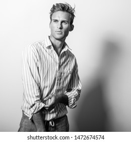 Elegant young handsome man in classic shirt. Black-white portrait.