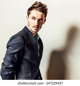 Elegant young handsome man in costume. Studio fashion portrait.