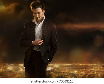 Elegant young handsome man over night city background