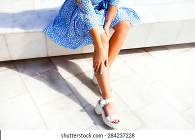 Elegant young lady in fashionable shoes isolated on white.Summer footwear,trendy summer shoes,close-up summer flower dress,ex provence,sunshine teenager girl,glowing skin,french fashion dress,florists