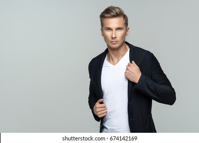 Elegant young male model in studio