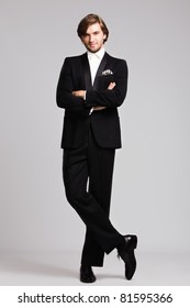 elegant young man in black tuxedo, full body shot,  studio shot
