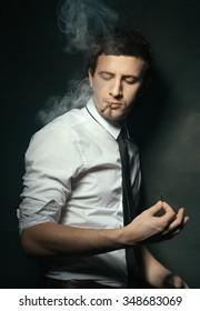 Elegant young man smoking
