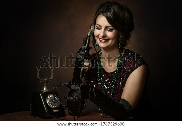 Elegant young woman in the 1920s as a telephone operator