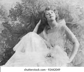 An elegant young woman in a fashionable dress