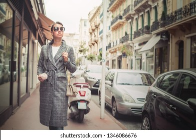 Elegant young woman in the Old town of Cannes, France