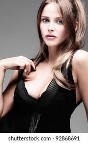 elegant young woman in provocative dress, studio shot