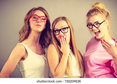 Elegant young women wearing funny nerd eyeglasses. Education and studying females look concept.