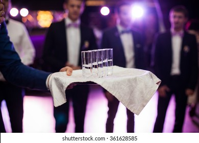 Elegantly served vodka shots on platter at weddin reception closeup