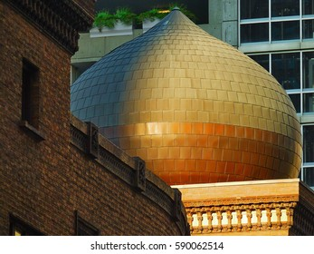Elegantly shaped onion dome is illuminated by the setting sun.