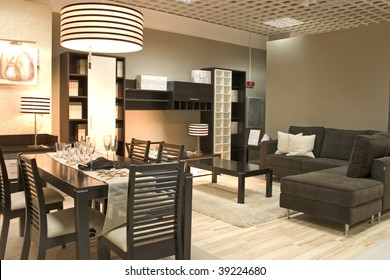 Elegnat dining room black colors. Coffe table with sofa and dining table with glasses.