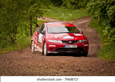 "ELEKTRENAI, LITHUANIA - MAY 21: Tomas Bilius drives an Autoralis team Honda Civic car during ""Vilniaus ralis 2011"", on May 21, 2011 in Eleketrenai, Lithuania"