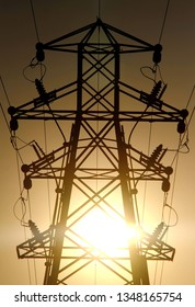 Elelctricity pylon at subset with golden sky