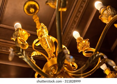Element of beautiful crystal chandelier in a room. Close-up