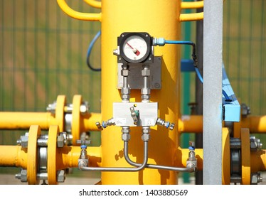 Element gas line high and medium pressure. Yellow transport pipes on the surface of the fence. Regulatory supply system for natural compressed fuel. Access overlap valves and pressure sensors.