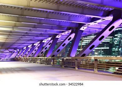 Element of modern bridge with illuminations at night