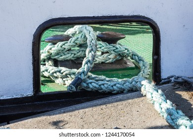 element for mooring ships .  Close-up of a Mooring rope with a knotted and tied around a cleats. seaworthy art, reliability and safety.