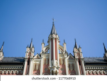 an element of a newly-built old-fashioned building with neogothic-styled elements