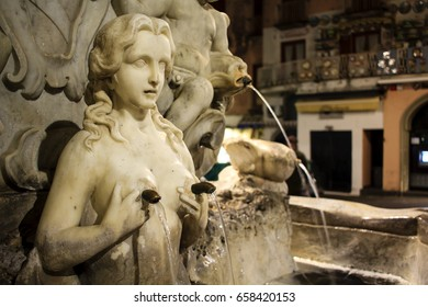 Element of the Saint Andrew's Fountain at Piazza del Duomo in Amalfi town, Amalfi coast, Italy. Fountain represents a woman holding her breasts with water pouring from her nipples.