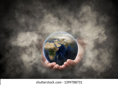 Element of this image furnished by Nasa, Hands that protect earth and the environment from pollution is concept, Safe world concept