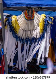 Element of traditional Indian American costume, feather headdress , white feathers and blue and white ribbons