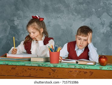 Elementary emotional school kids working at their vintage  desk , Retro concept