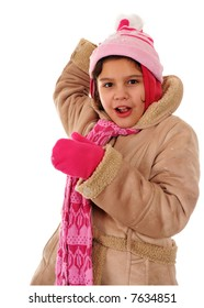 An elementary girl ready to throw a snowball at the viewer.