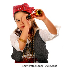 """An elementary """"pirate"""" peering through her spyglass.  Isolated on white."""