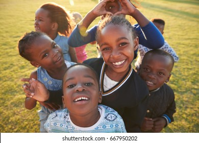 Elementary school kids having fun outdoors, high angle