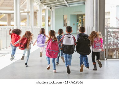 Elementary school kids run from camera in corridor c5393c1377