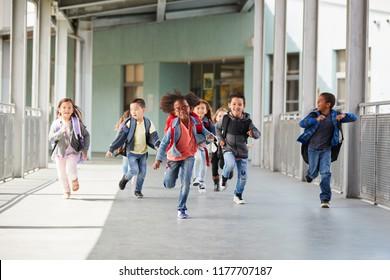 Elementary school kids running in a corridor in the school