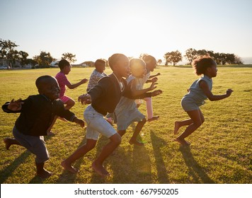 Elementary school kids running together in an open field