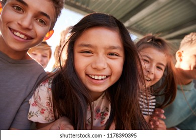 Elementary school kids smiling to camera, close up