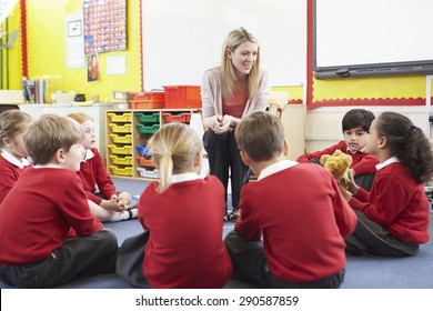 Elementary School Pupils Telling Story To Teacher