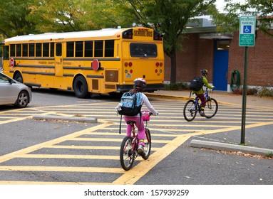 Elementary school students bike to school on International Walk and Bike to School Day